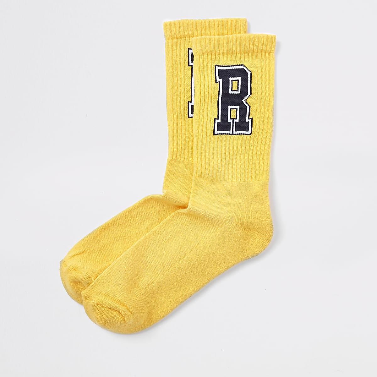 Yellow 'R' tipped tube socks