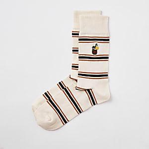 Ecru gestreepte sokken met kokosnootprint