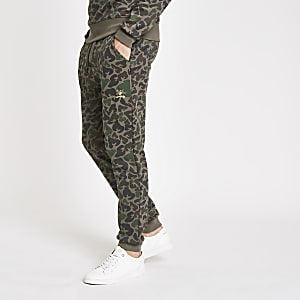 Money Clothing – Dunkelbraune Jogginghose mit Camouflage-Muster