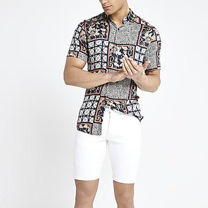 White ripped skinny denim shorts