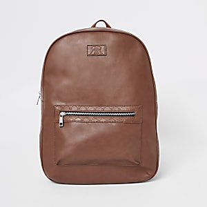 Light brown RI monogram trim backpack