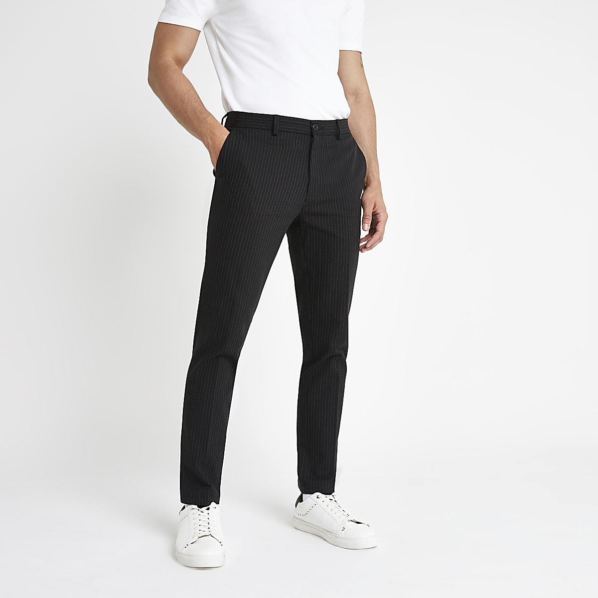 Marineblauwe skinny-fit broek met krijtstreep