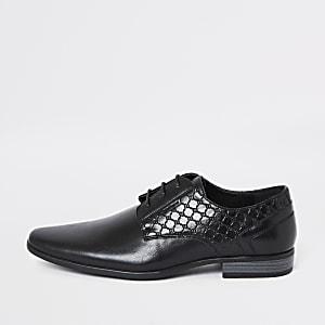 Black 'RI' embossed derby shoes
