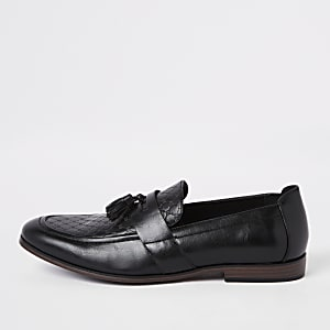 Zwarte loafers met RI-monogram en kwastjes