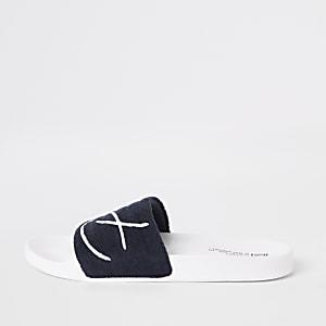 Marineblauwe geborduurde slippers met 'Prolific'-print