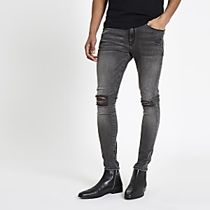 Ollie - Zwarte spray-on jeans met ripped knie
