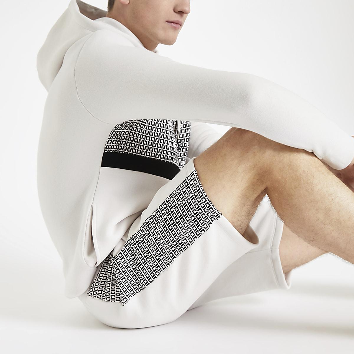 R96 stone RI monogram slim fit jersey shorts