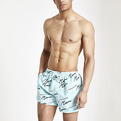 Blue 'Miami night' printed swim shorts