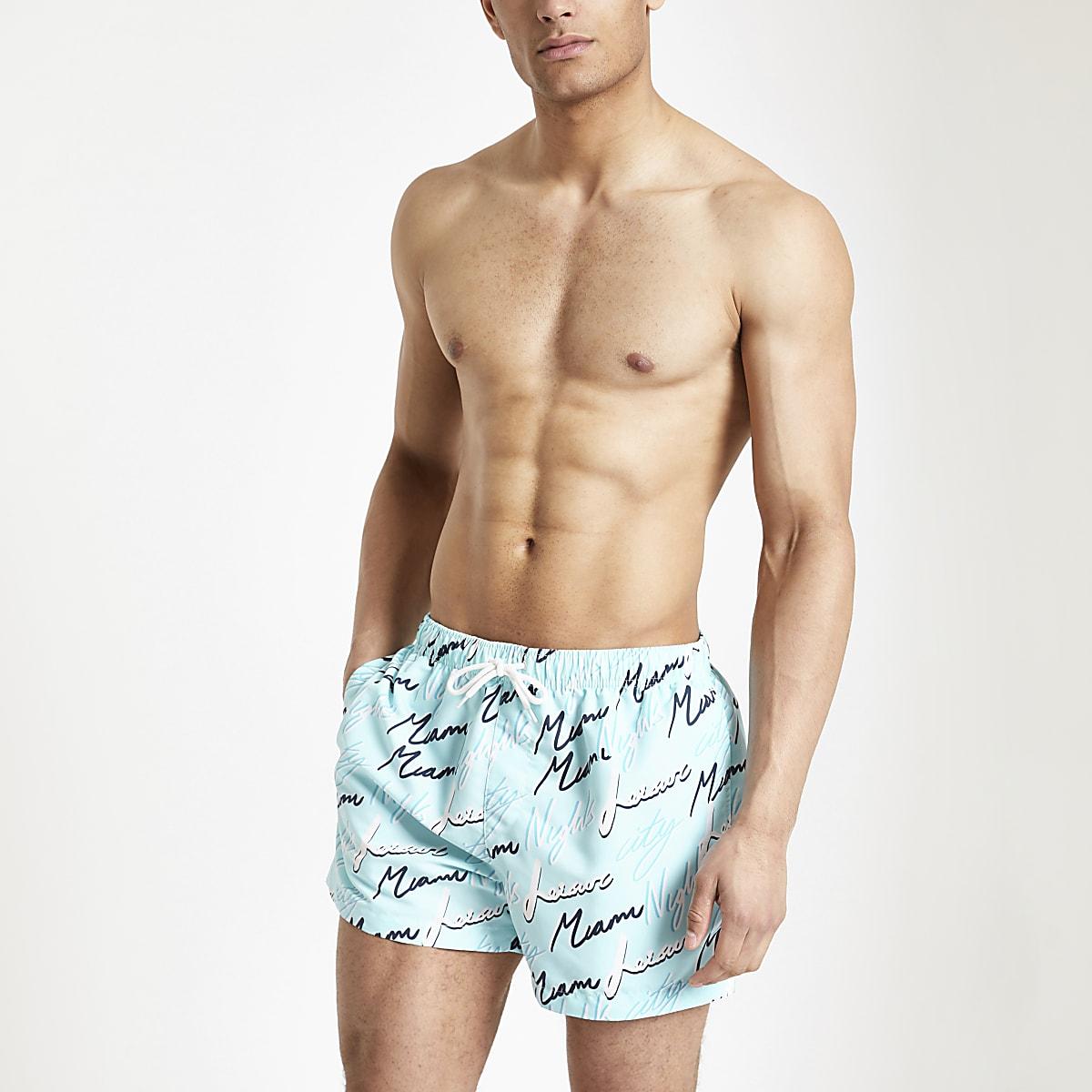 Short de bain imprimé «Miami night» bleu