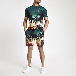 Blaue Slim Fit Jerseyshorts mit Palmenprint