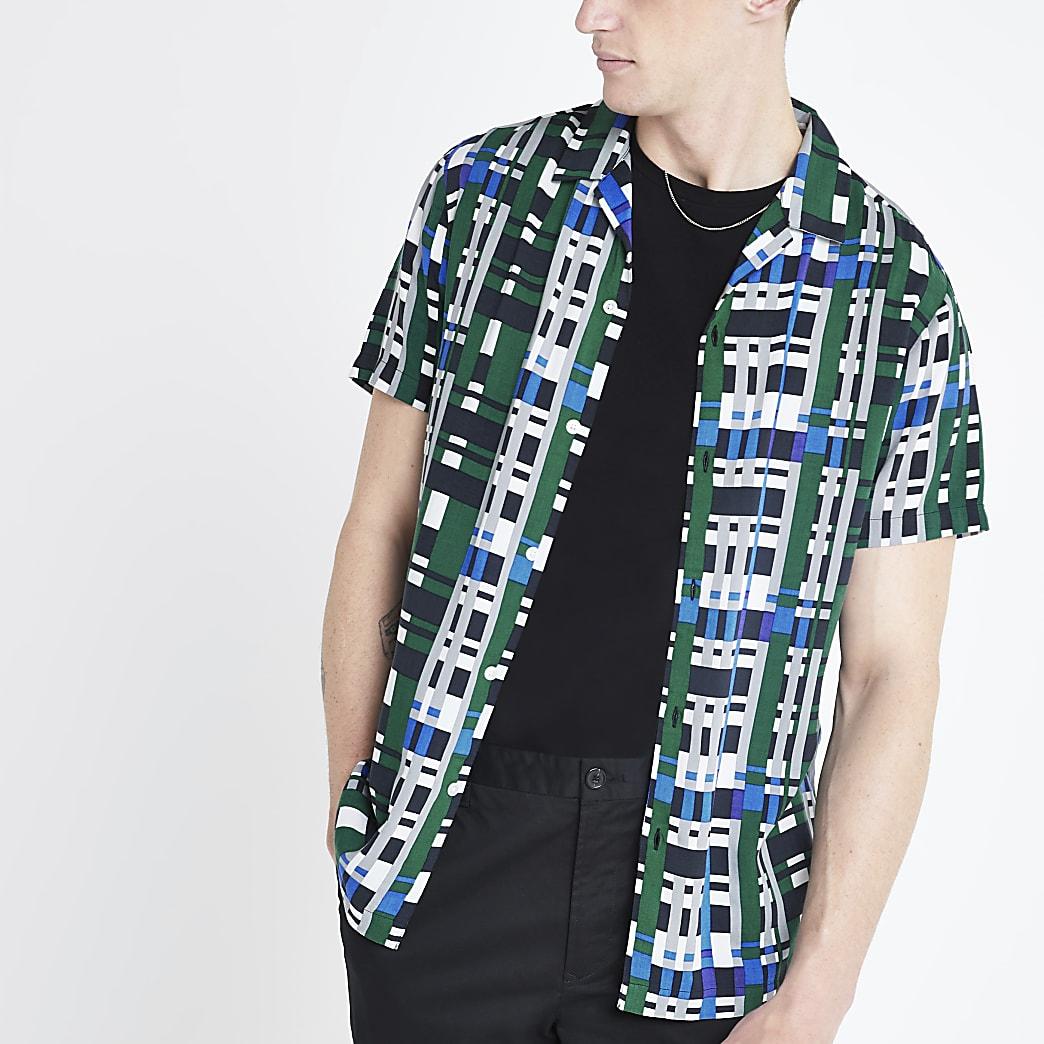 Chemise classique bleue à carreaux et manches courtes