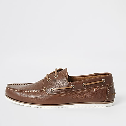 Brown leather lace-up boat shoes