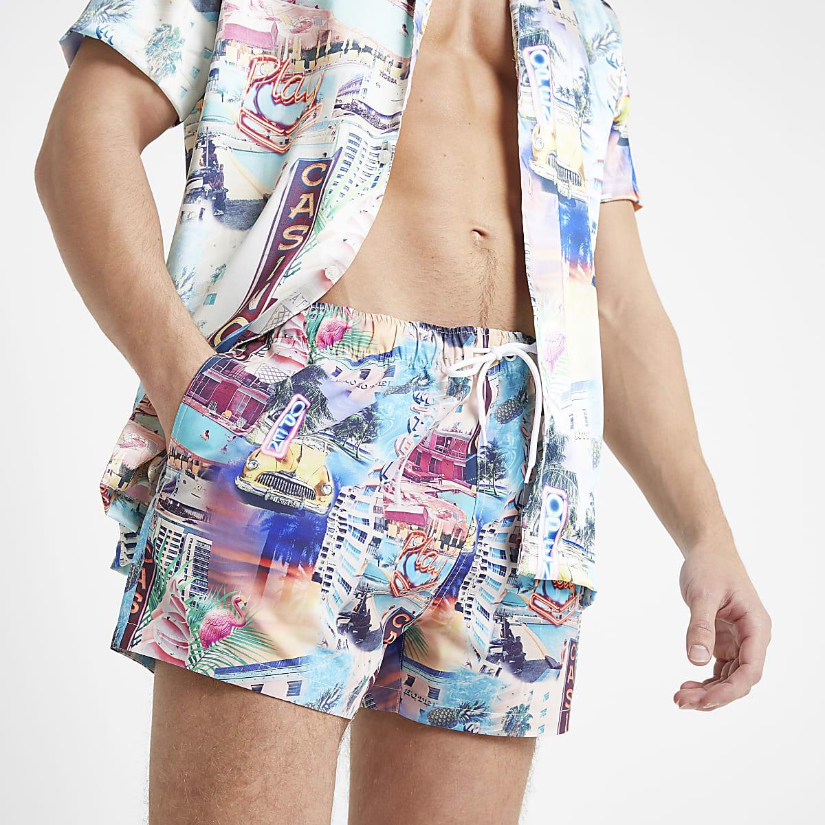 Blue graphic print swim trunks