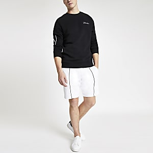 White piped slim fit jersey shorts