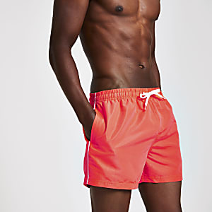 Neon red piped swim shorts