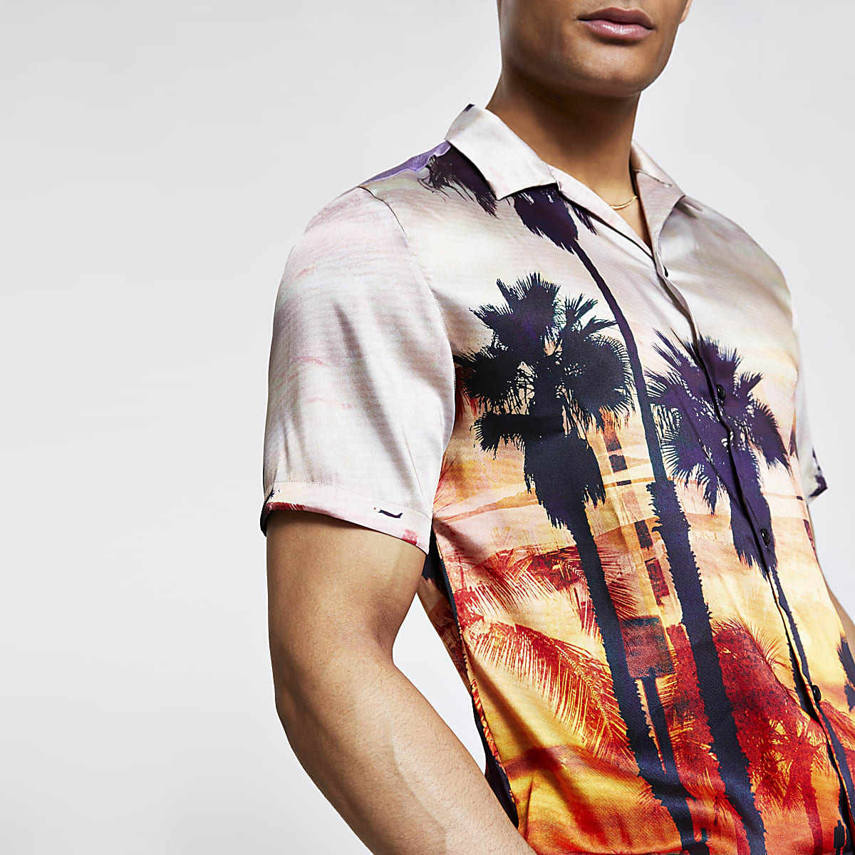 Oranje overhemd met palmbomenprint en korte mouwen