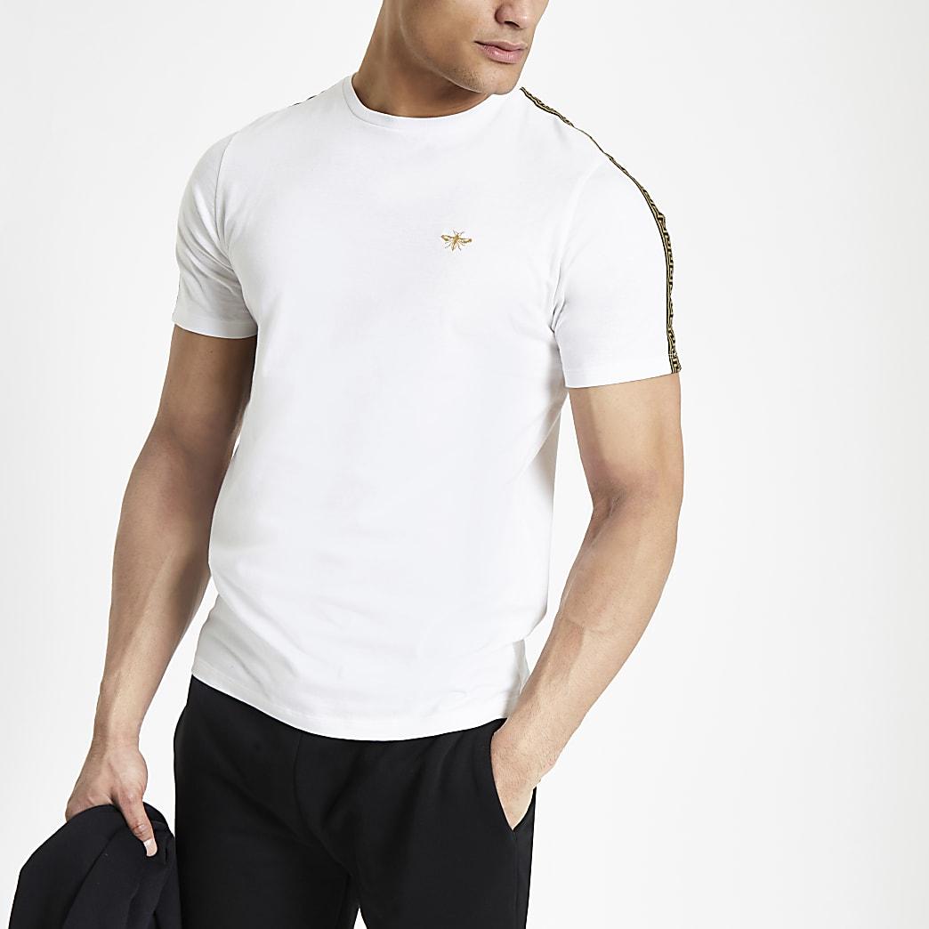 T-shirt blanc avec motif guêpe brodé et bandes latérales