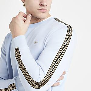 Blauwe slim-fit sweatshirt met geborduurde wesp