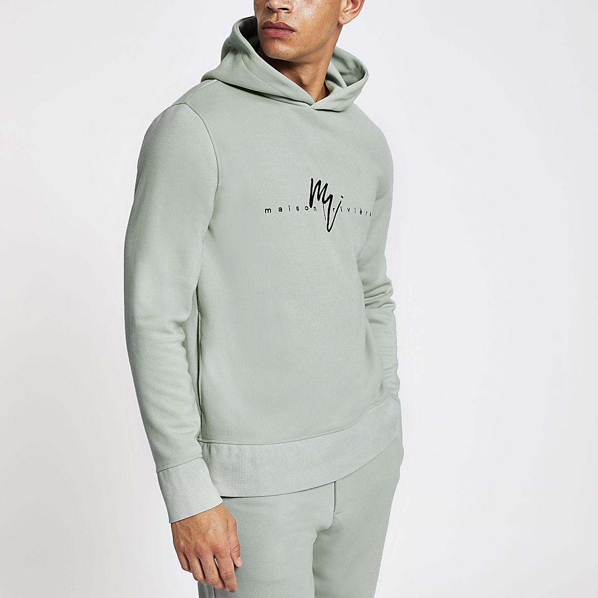 Lichtgroene slim-fit hoodie met Maison Riviera-print