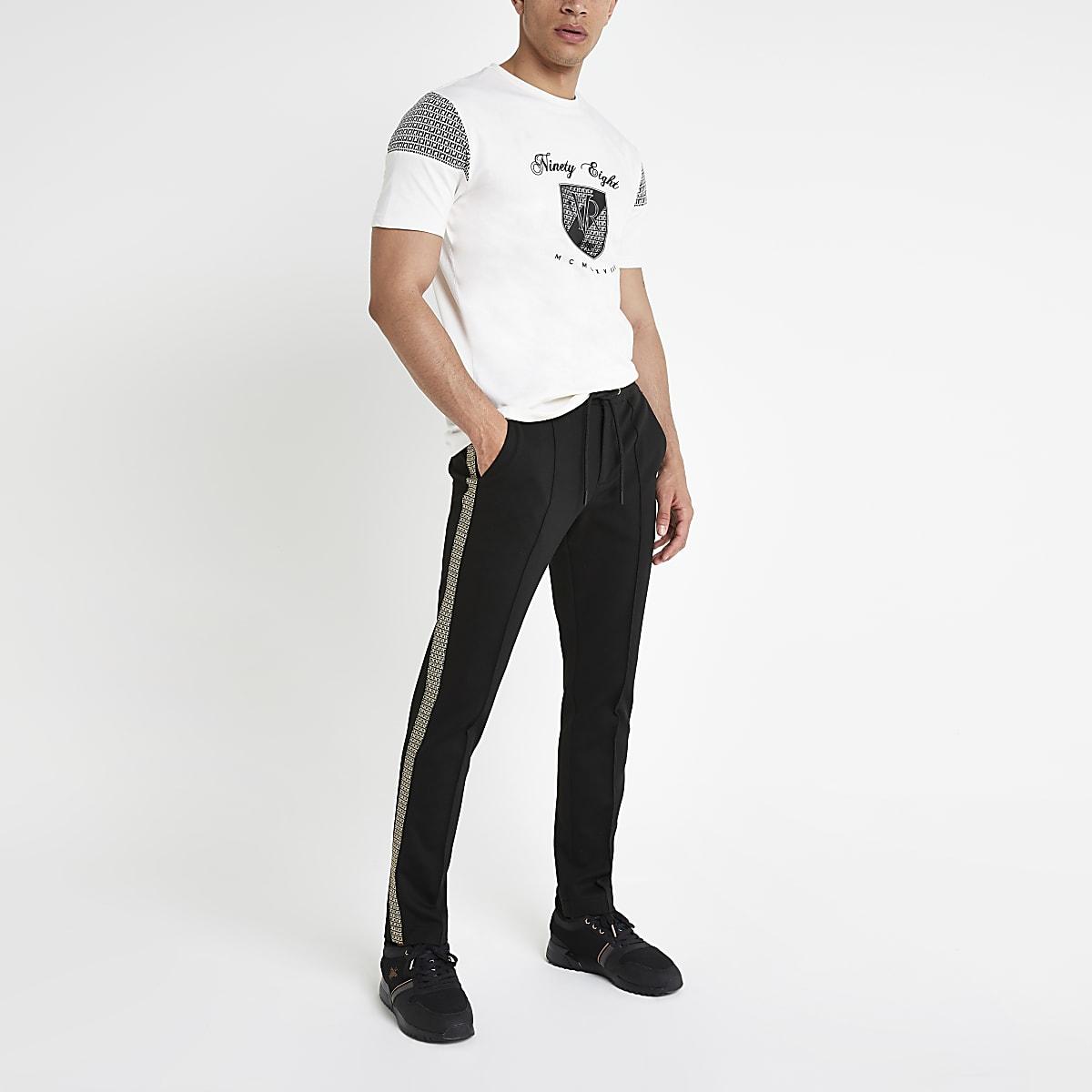 Nette Joggingbroek.Zwarte Skinny Fit Nette Joggingbroek Met Bies Modieuze Broek