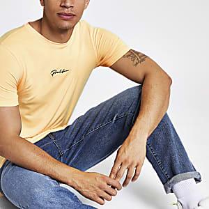 Oranje aansluitend T-shirt met 'Prolific'-print