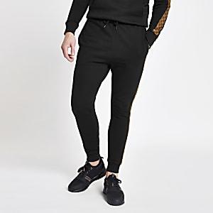 Criminal Damage – Pantalon de jogging noir avec empiècements à carreaux