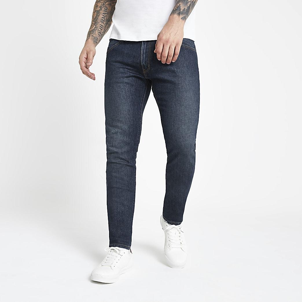 Wrangler – Dunkelblaue Skinny Fit Jeans