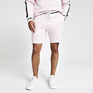 Roze slim-fit jersey short met 'Prolific'-print