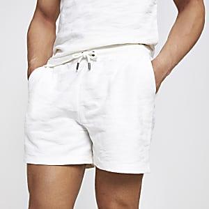 Ecru slim-fit jersey short met textuur en camouflageprint