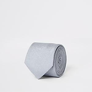 Cravate à fleurs grise