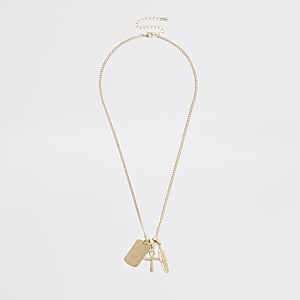 Gold tone feather dog tag necklace