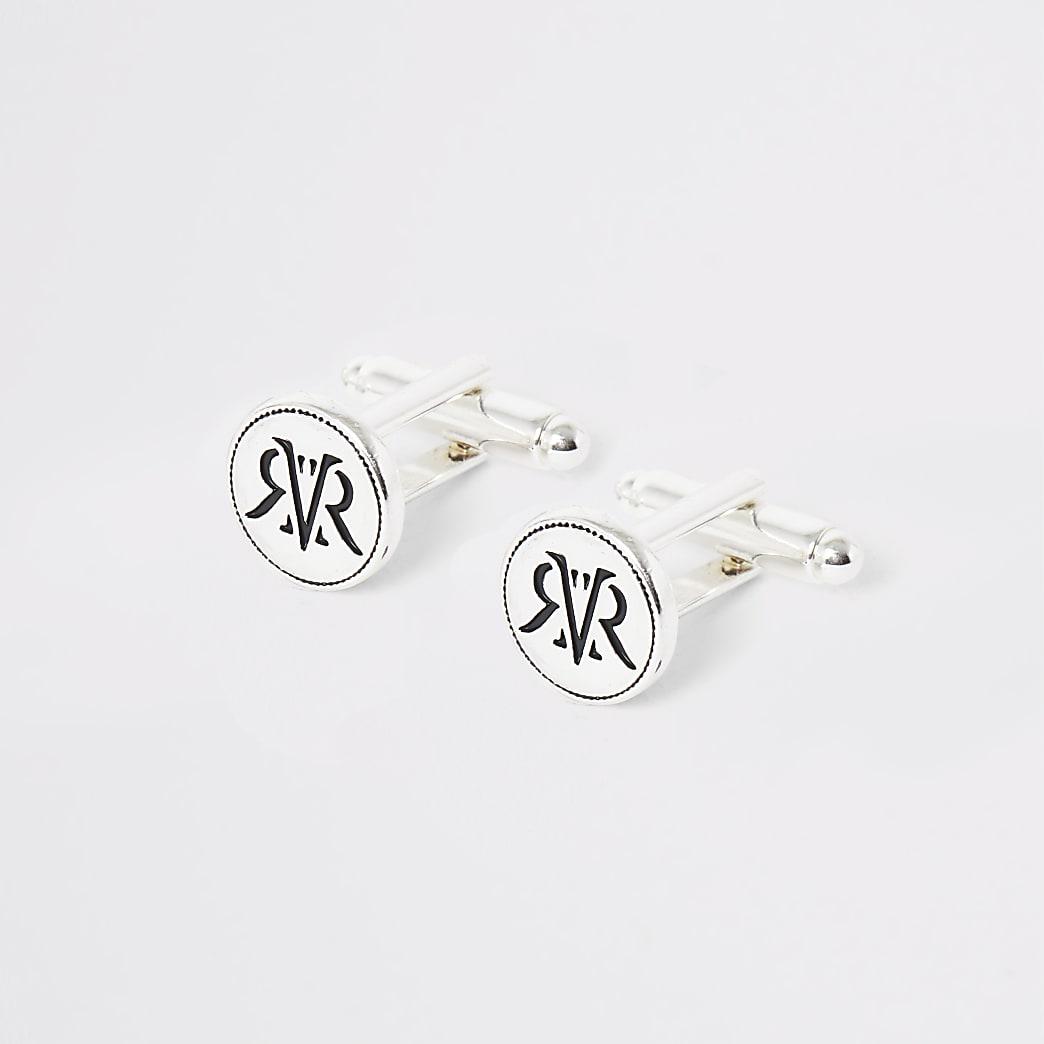 Zilverkleurige manchetten met RI-logo