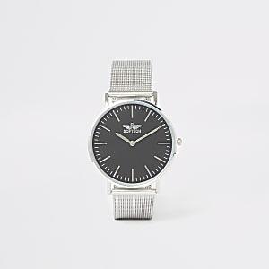 Silberne, runde Armbanduhr mit Mesh-Armband