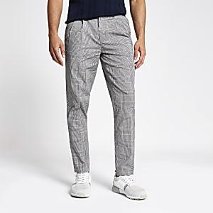 Pantalon fuselé à carreaux gris
