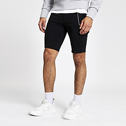Black utility chain skinny shorts