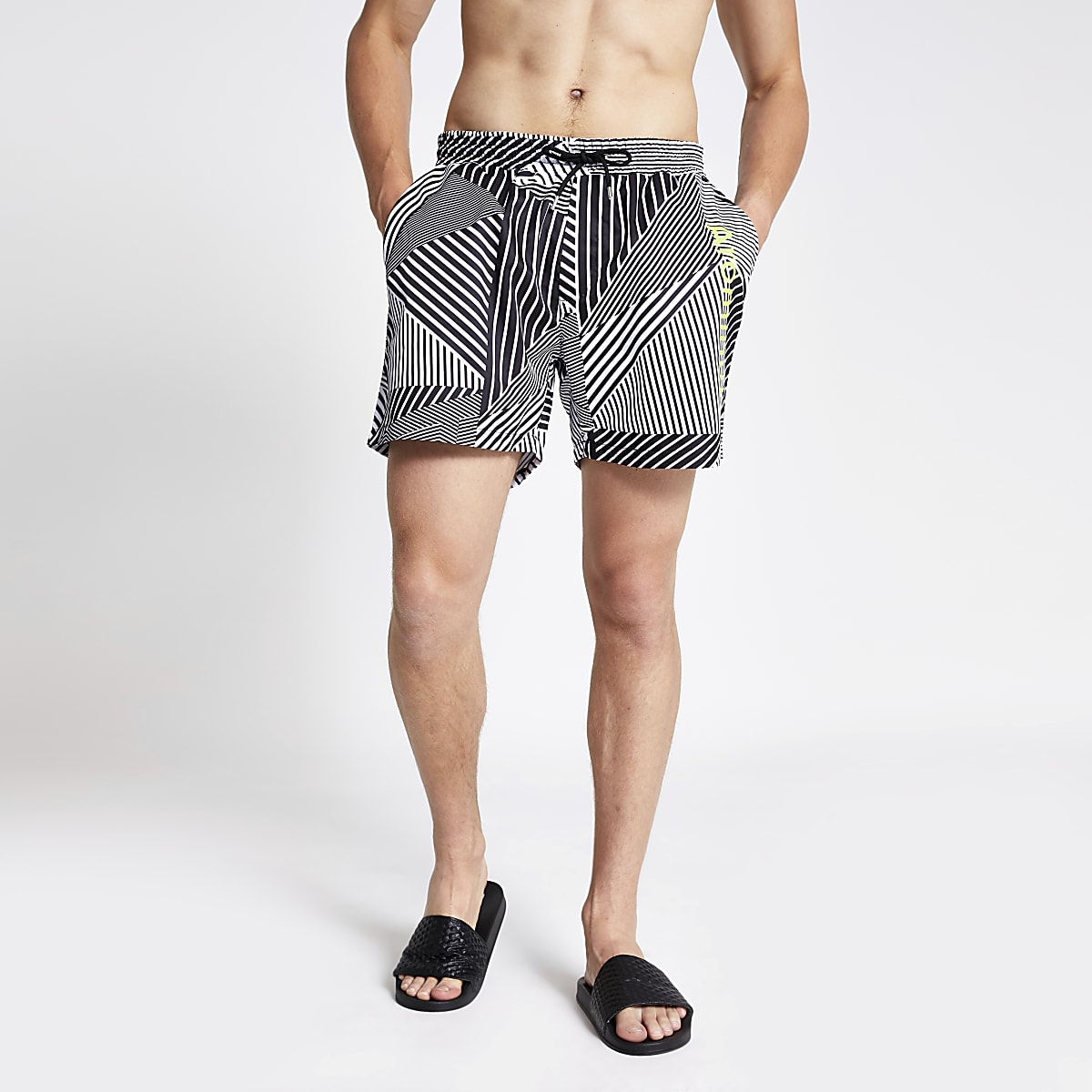 Arcminute black geo print swim shorts