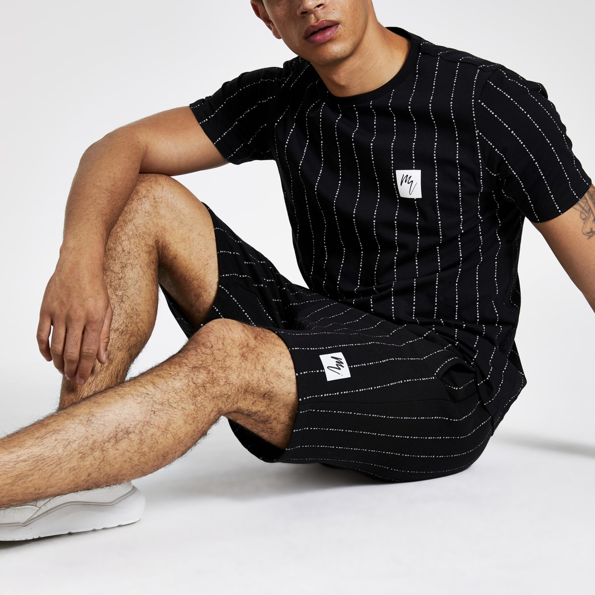 Zwart gestreept T-shirt met 'Maison Riviera'-print