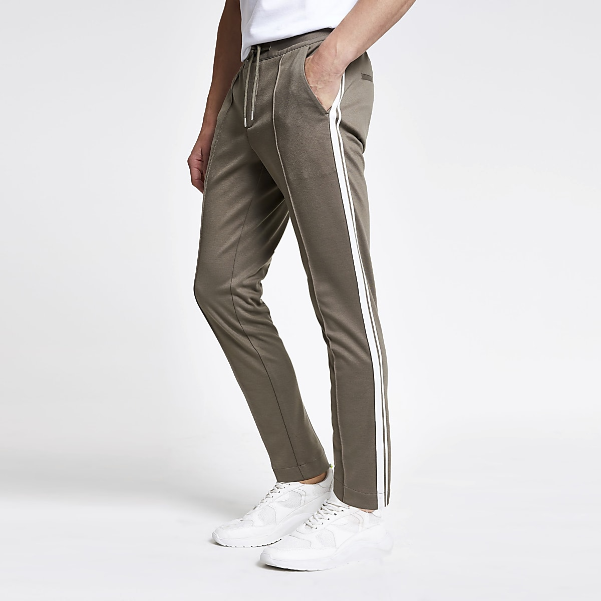 Light green skinny tape trousers