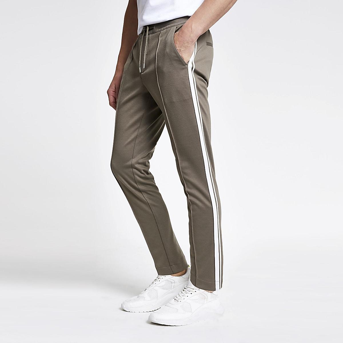 Light green skinny tape pants