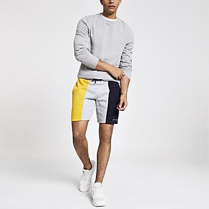 R96 yellow block slim fit jersey shorts