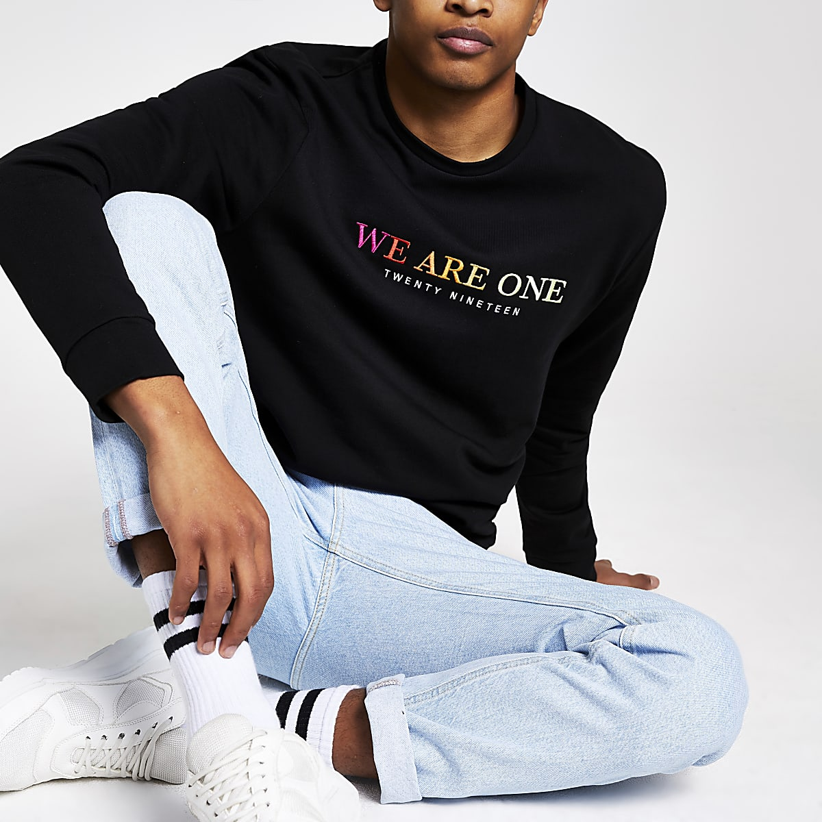 Black 'we are one' Pride sweatshirt