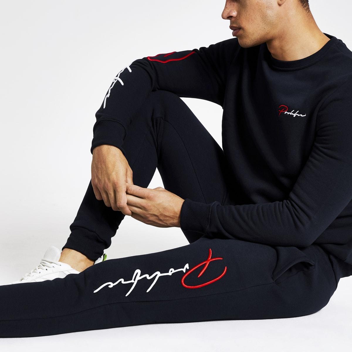 Marineblauwe slim-fit joggingbroek met 'Prolific'-print
