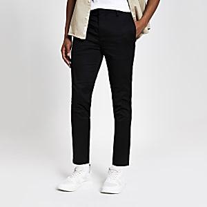 Zwarte skinny broek met bies opzij