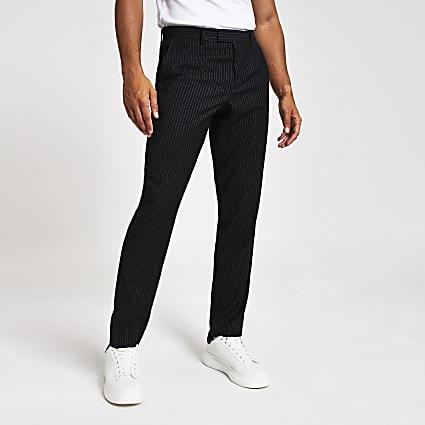 Navy pinstripe skinny suit trousers