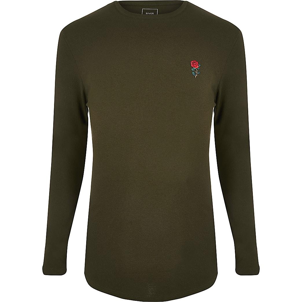 Donkergroen aansluitend T-shirt met lange mouwen
