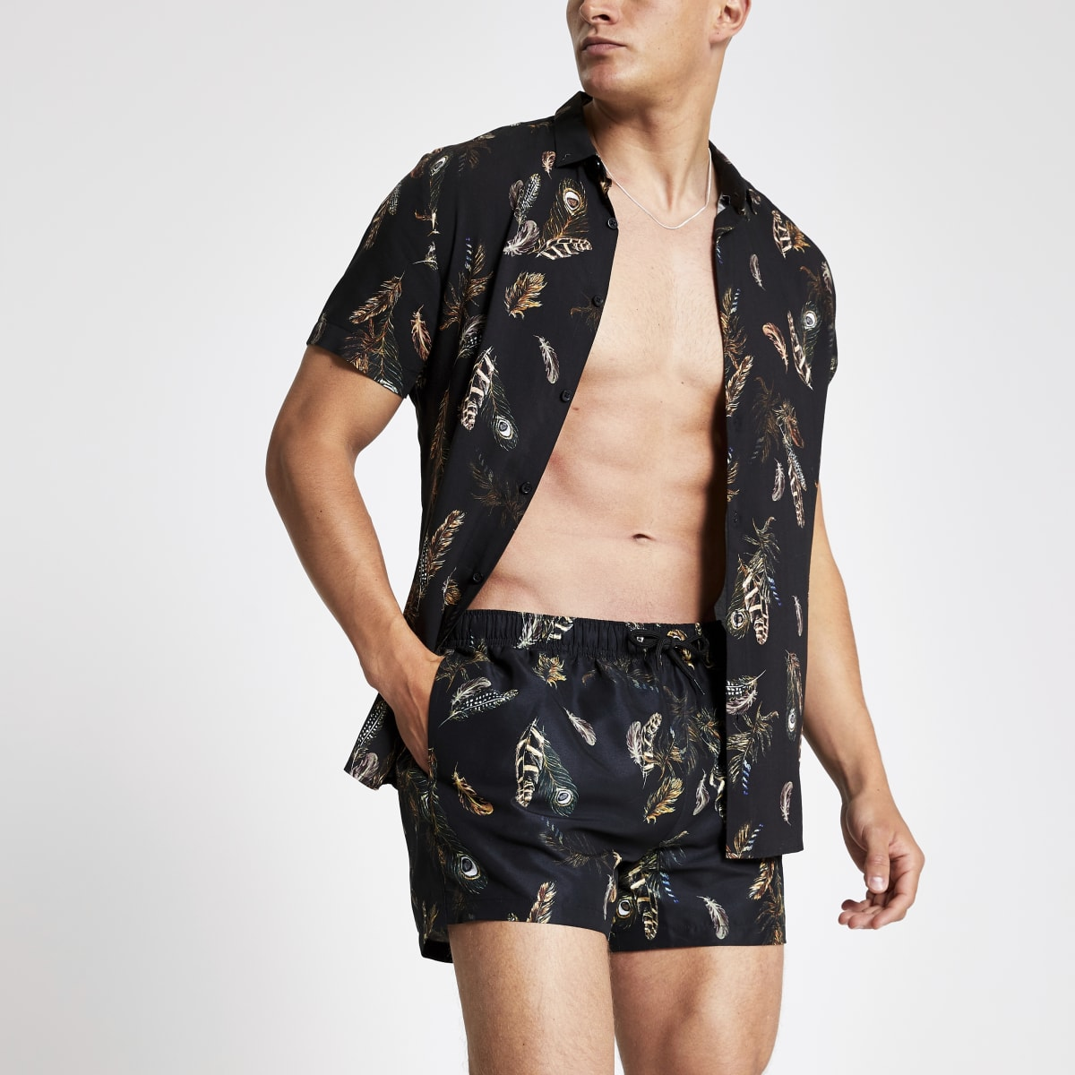 Black feather print swim shorts