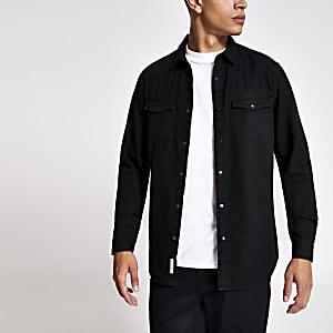 Zwarte denim overhemd met lange mouwen en twee zakken