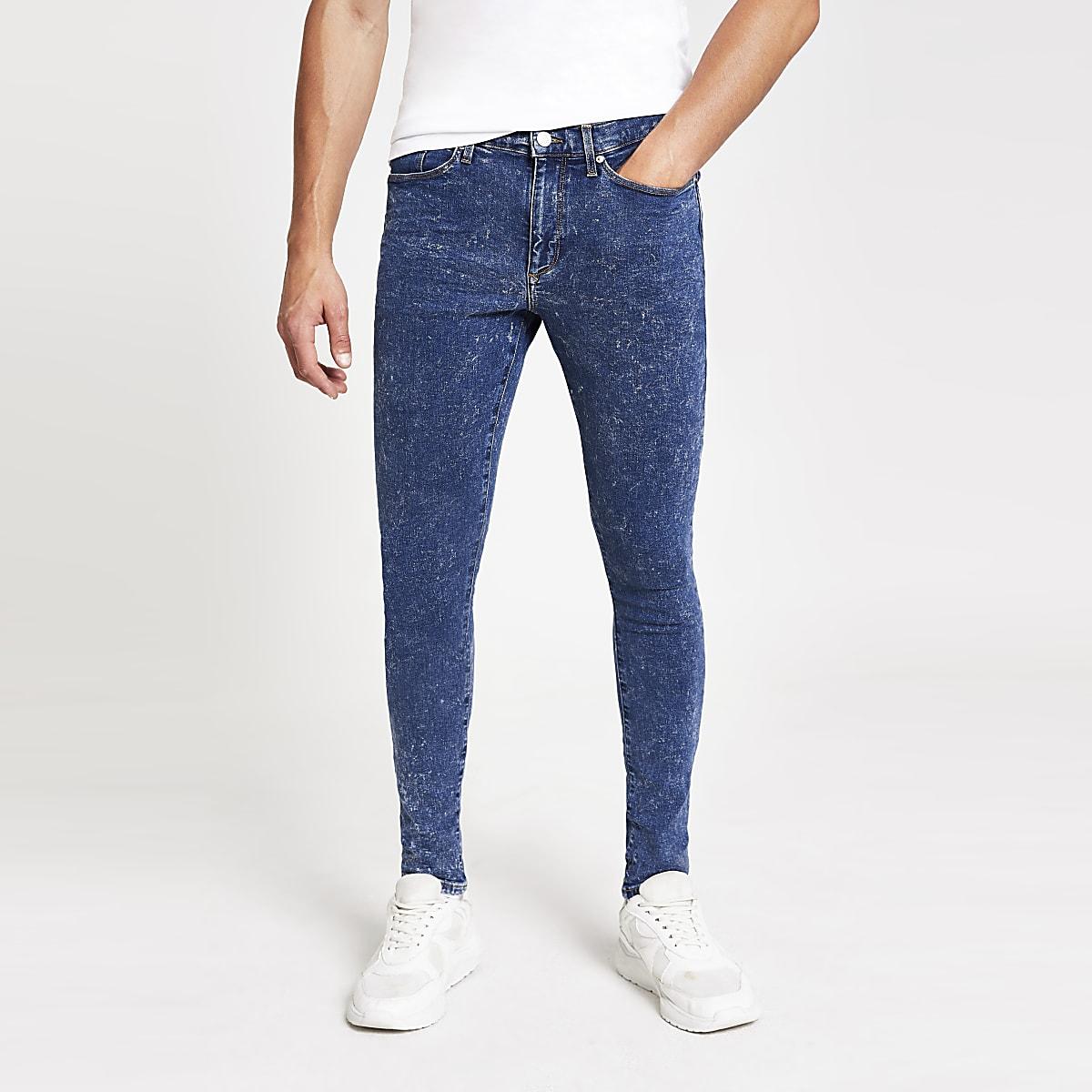 Mid blue acid wash Ollie spray on jeans