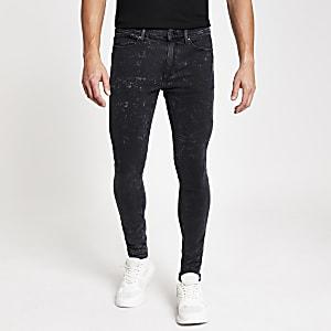 Black acid wash Ollie spray on jeans