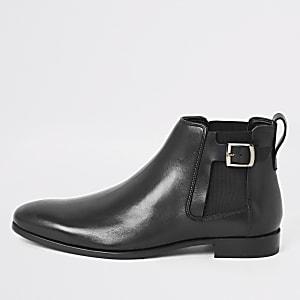 Bottes en cuir noir à boucle sur le côté